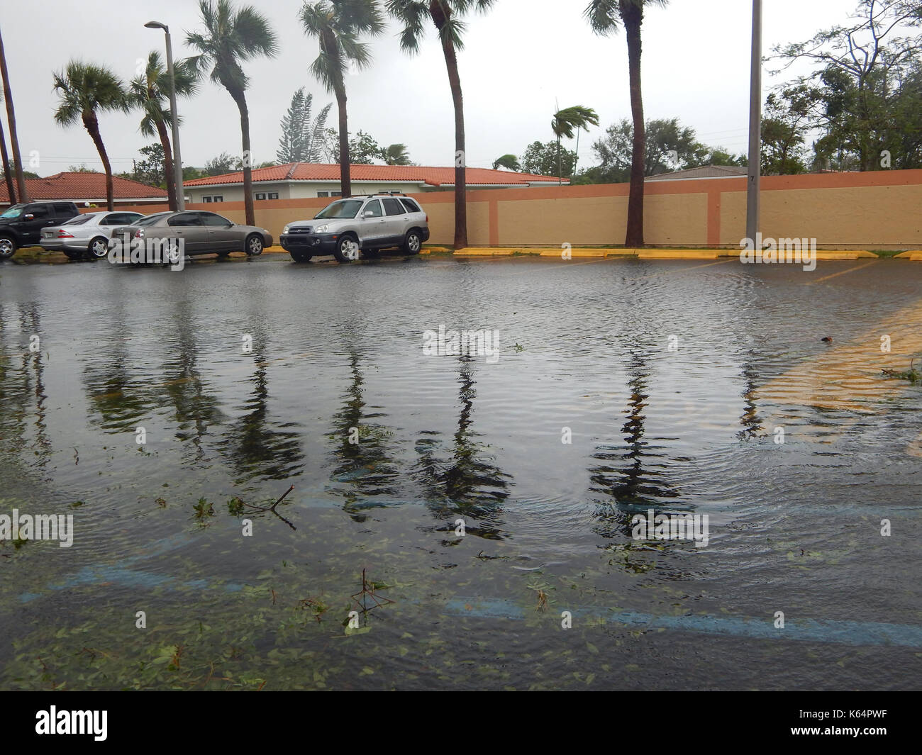 Miami, United States. 12th Sep, 2017. View of a parking lot after Hurricane Irma, in the Kendall district of Miami, Florida, USA, 11 September 2017. Florida has dawned and confirmed the bad omens given by meteorologists on the destructive power of Hurricane Irma, which has already claimed at least six deaths in Florida, three in Georgia and one in South Carolina and keeps more than 6.7 millions of properties in the dark. Credit: Latif Kassidi/EFE/Alamy Live News - Stock Image