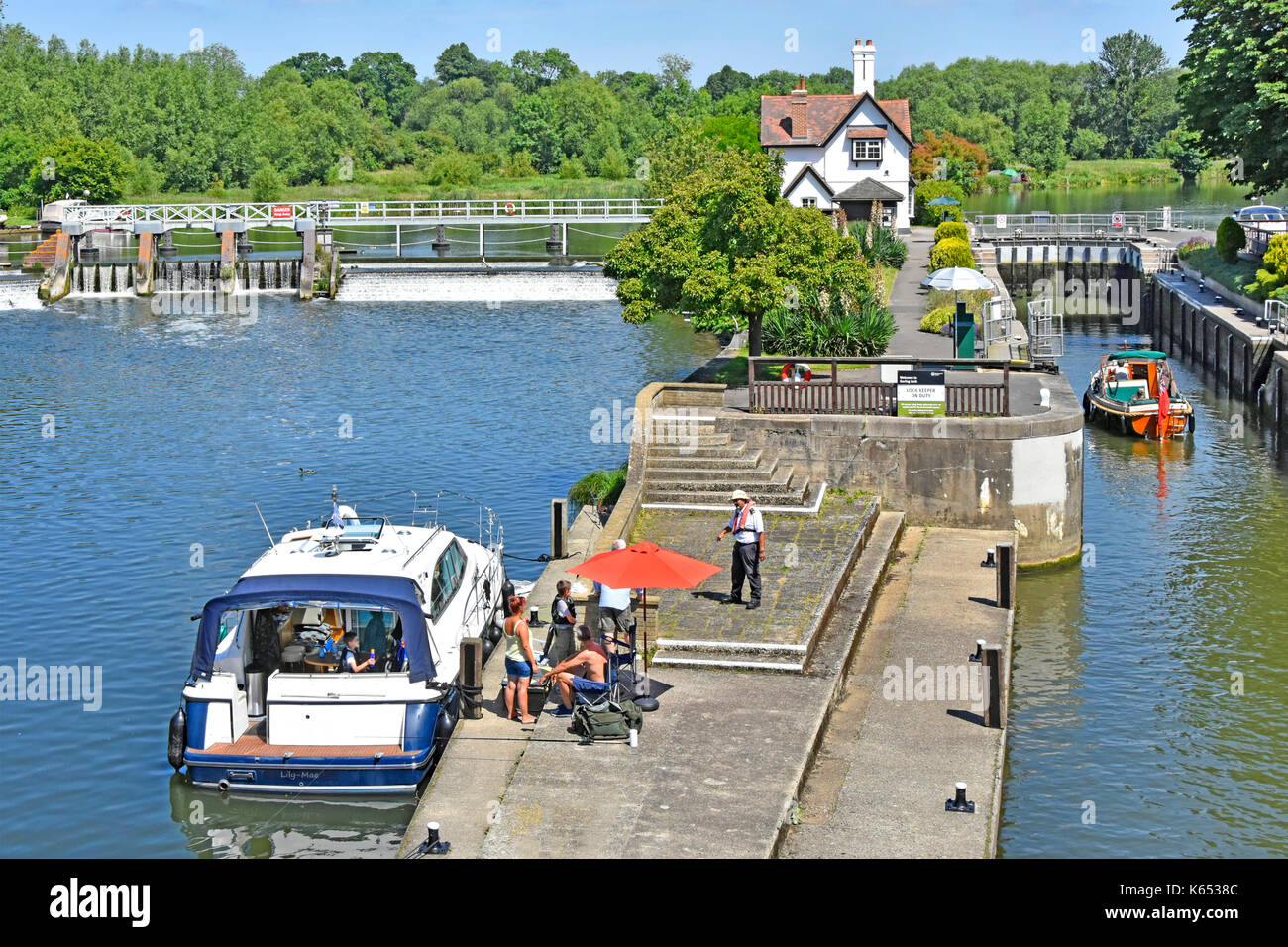 Looking down from above at approach to Goring Lock on River Thames in Oxfordshire with Streatley Berkshire on far side beyond weir - Stock Image