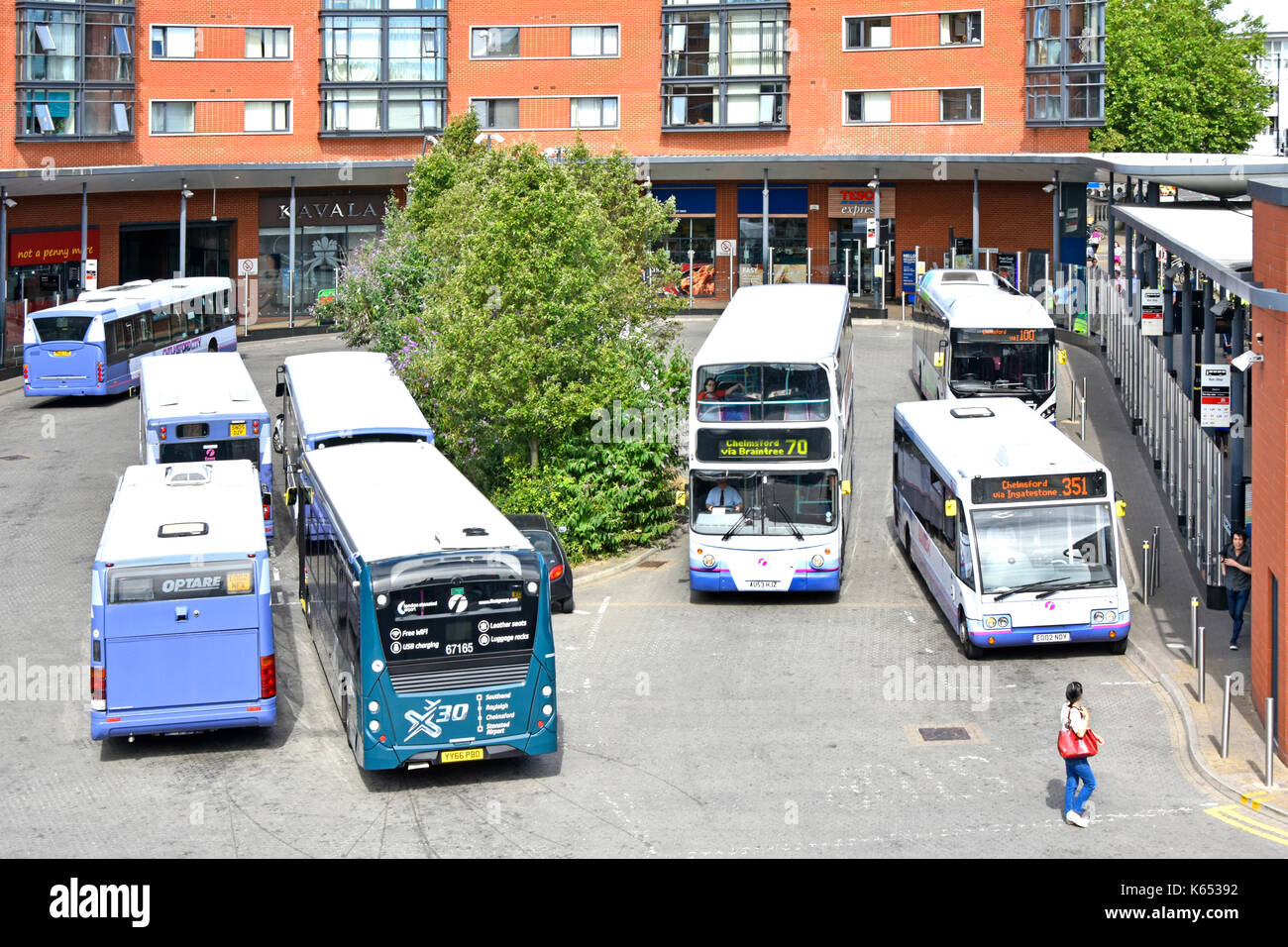 View from above looking down at buses Chelmsford town centre bus station which includes small selection of retail Stock Photo