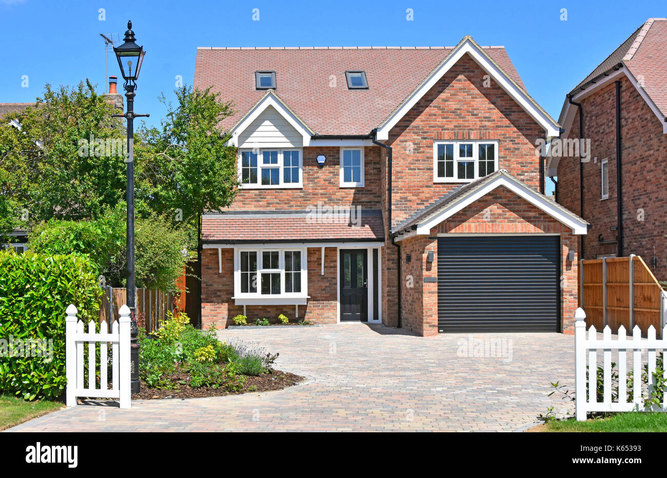 New home for sale detached five bedroom new build property one of two on demolished cottage plot in village location near Brentwood Essex England UK - Stock Image