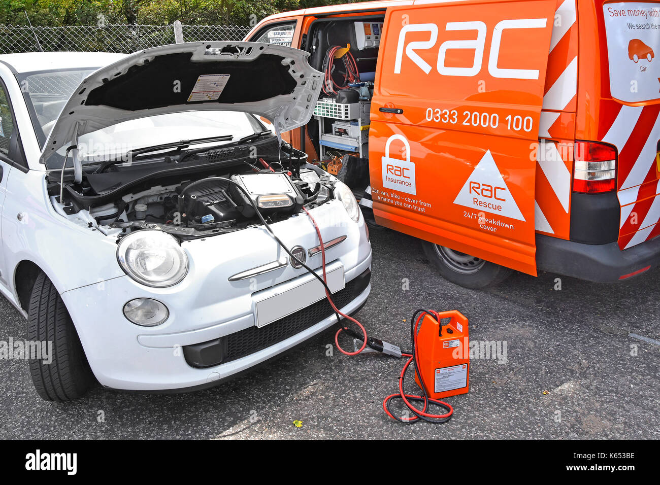 Close up RAC breakdown van in attendance tracing fault in broken down Fiat car diagnostic computer equipment connected Stock Photo