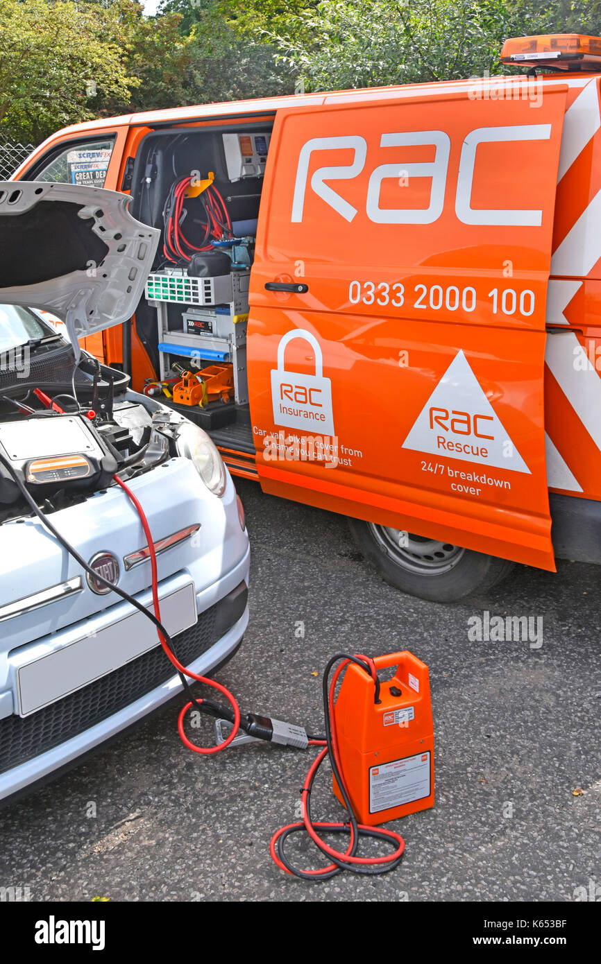 Close up of diagnostic computer equipment connected direct to car by RAC mechanic with RAC breakdown van parked beside broken down Fiat car - Stock Image