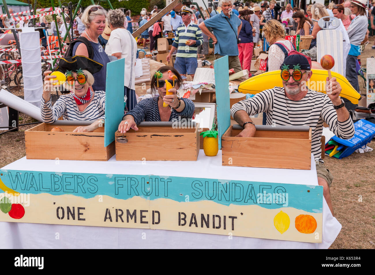 The one armed bandit stall at the village fete in Walberswick , Suffolk , England , Britain , Uk - Stock Image
