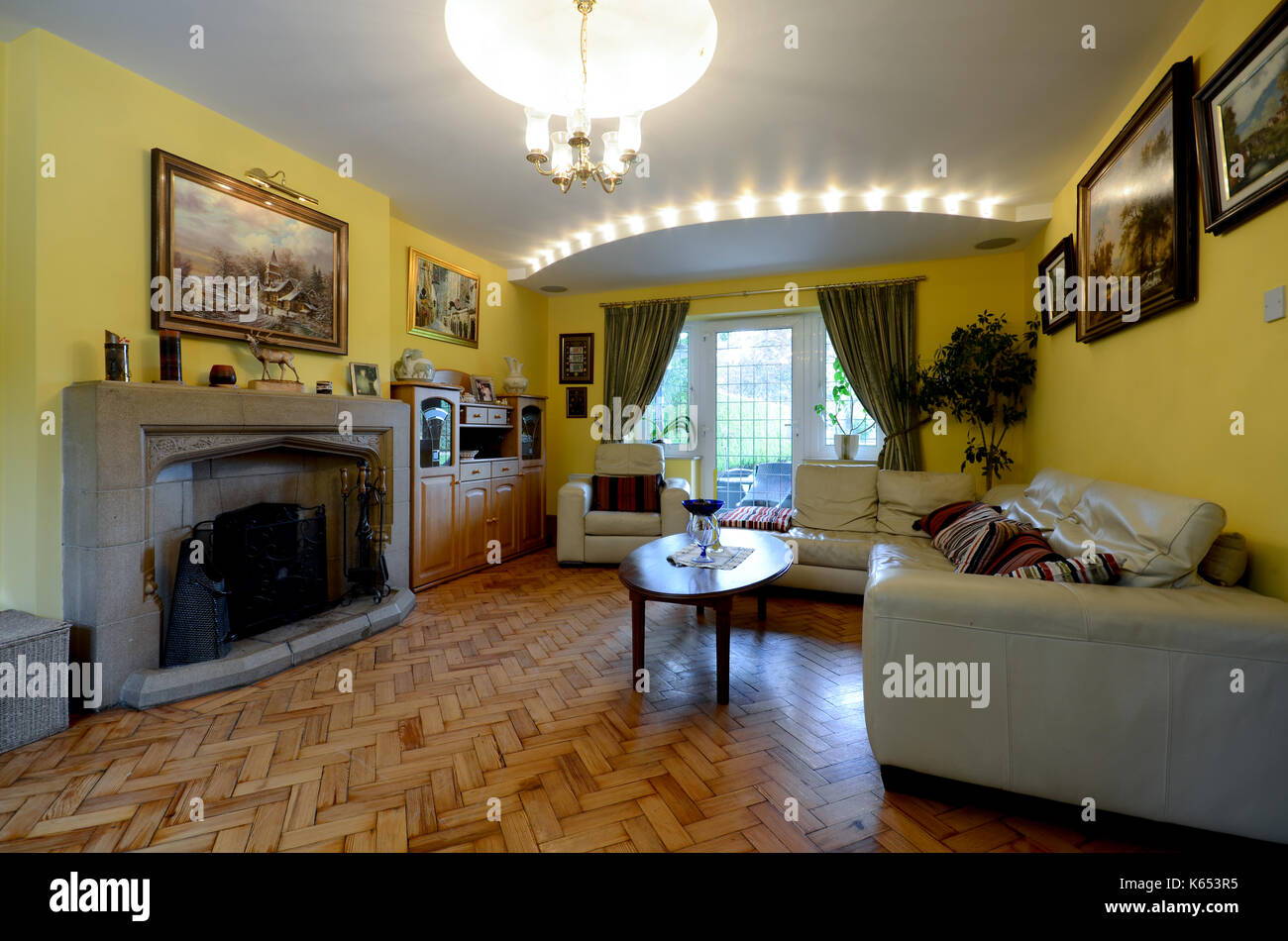 yellow living room with expensive led lights - Stock Image