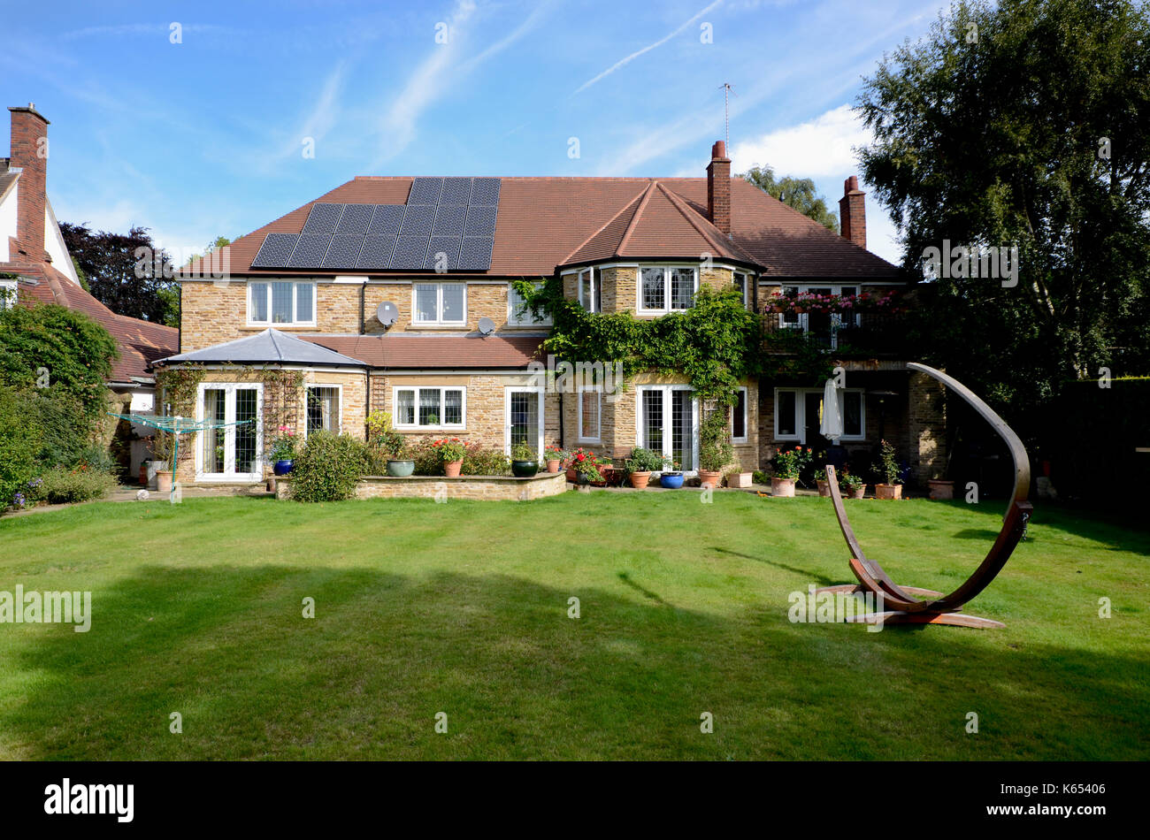 Solar panels on executive luxury home - Stock Image