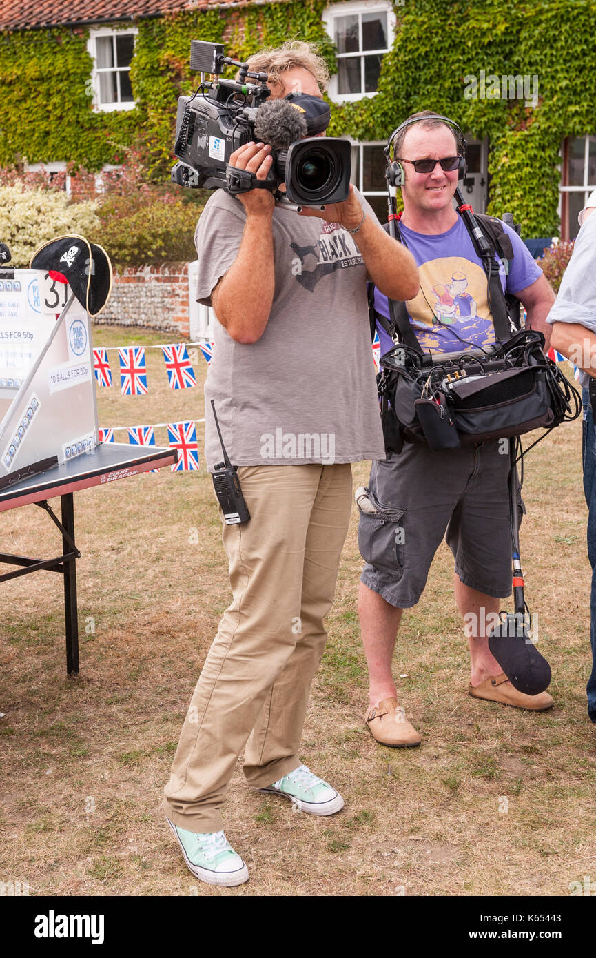 A TV cameraman at the village fete in Walberswick , Suffolk , England , Britain , Uk - Stock Image