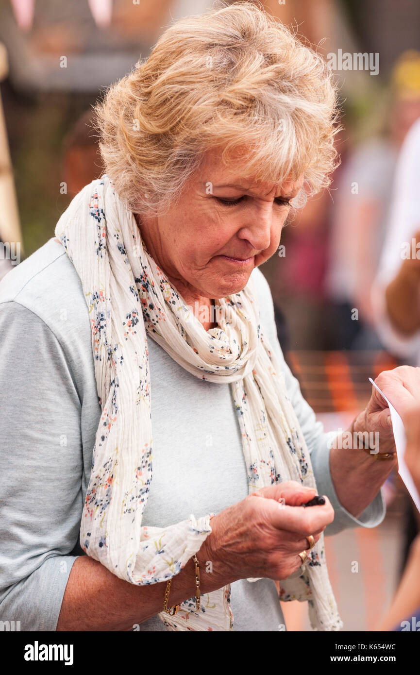 Penelope Keith filming Hidden Villages at the village fete in Walberswick , Suffolk , England , Britain , Uk Stock Photo
