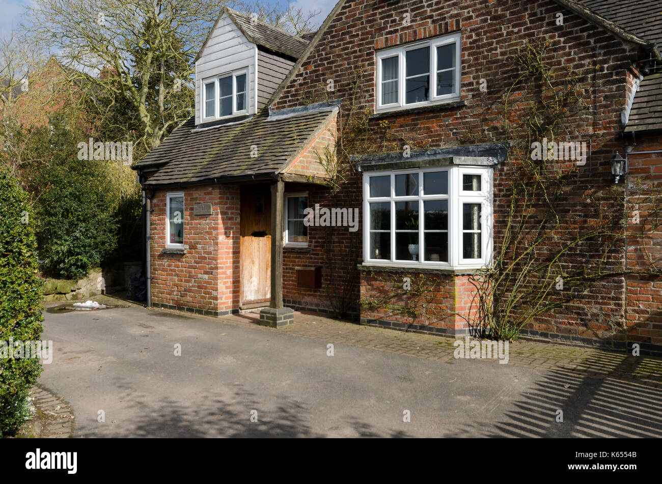 Front porch and bay window of Derbyshire cottage Stock Photo