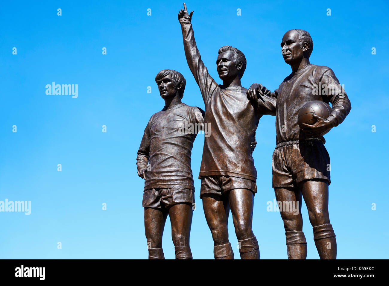 Manchester, UK - 4 May 2017: Statue Of Players Outside Manchester United Football Stadium - Stock Image