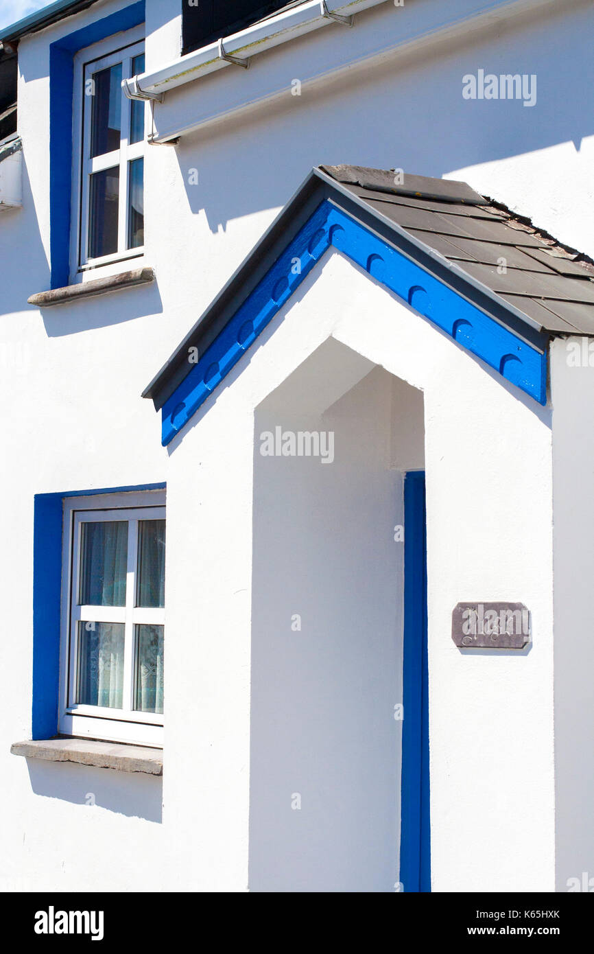 Small Blue and Bright White two storey cottage type houses with