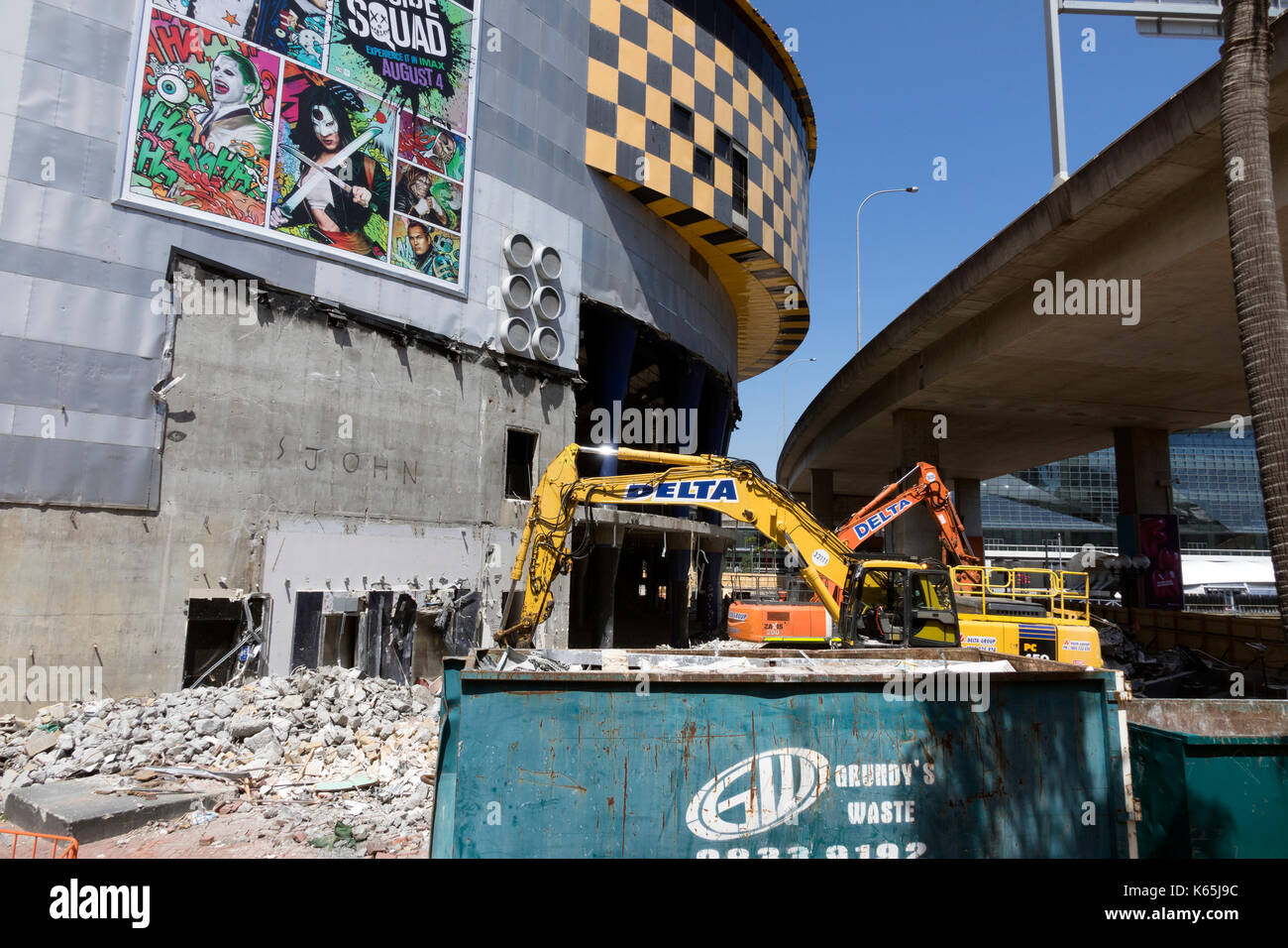 Demolition Machines Start Knocking Down The IMAX Theatre Building Sydney Australia Was The Largest Movie Screen In The World - Stock Image