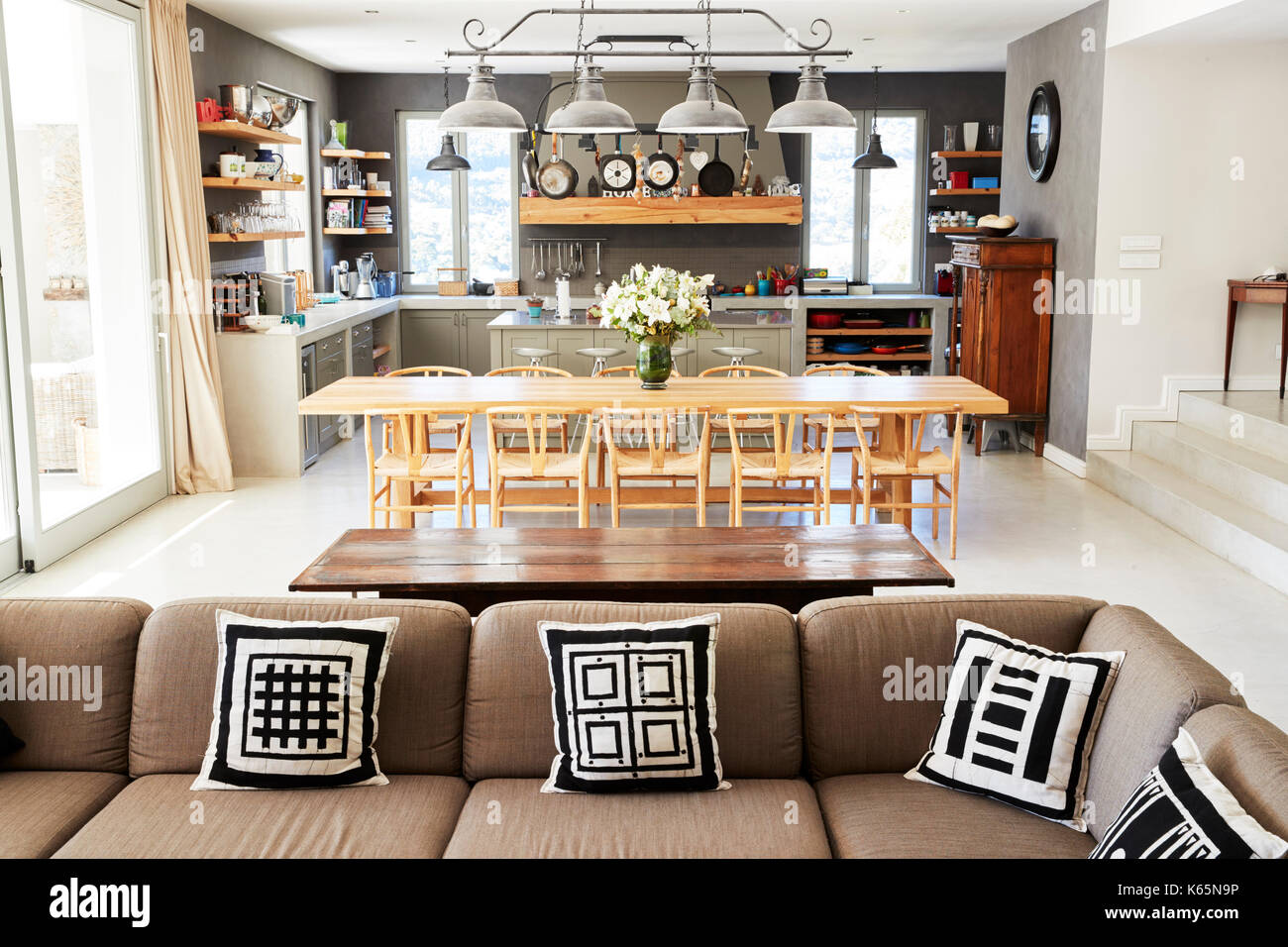 Home Interior With Open Plan Kitchen Lounge And Dining Area Stock Photo Alamy