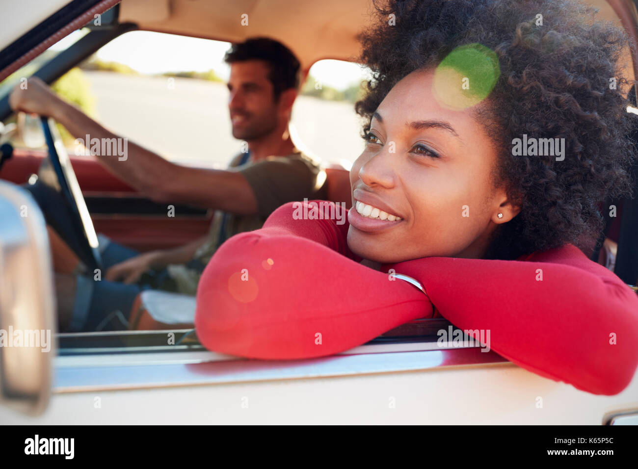 Young Couple Relaxing In Car During Road Trip - Stock Image