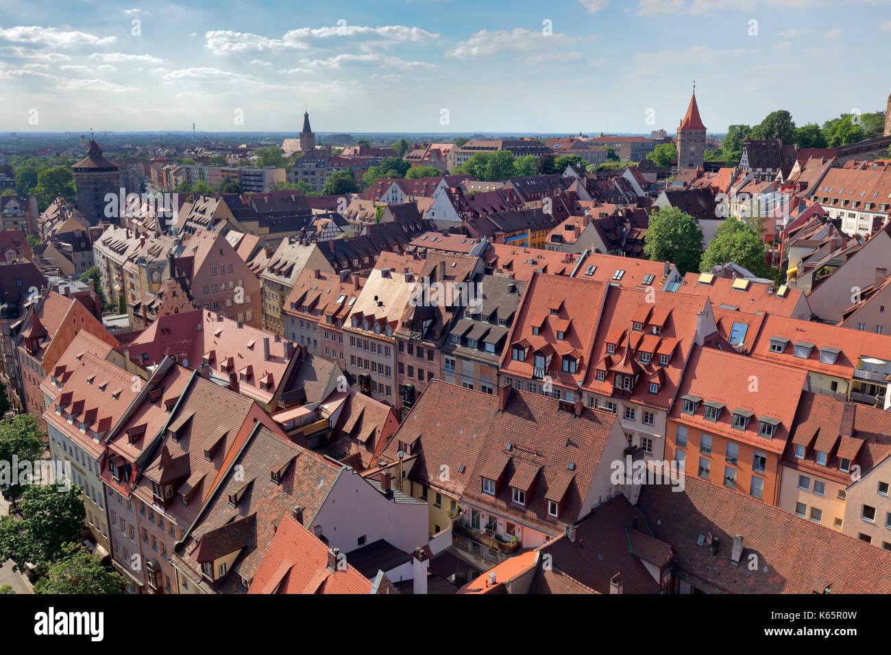 View of red roofs of the Sebalder Altstadt, old town, behind it district Johannis, from left the Spittlertorturm - Stock Image