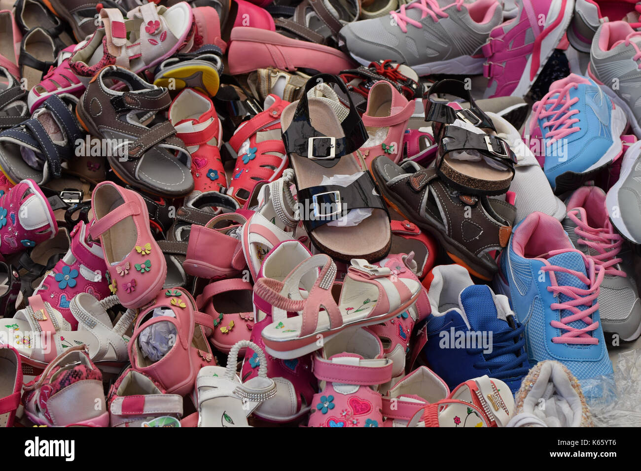 aaf76b7b661ce2 Kids shoes for sale at street market. Assorted pile of footwear. - Stock  Image