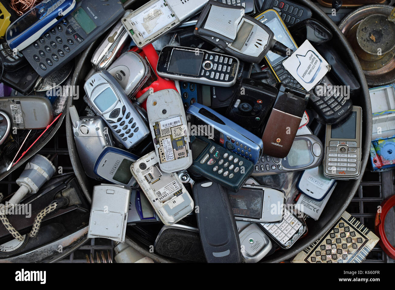 ATHENS, GREECE - AUGUST 4, 2016: Old mobile cell phones. Pile of broken handphones for sale at junk shop. - Stock Image