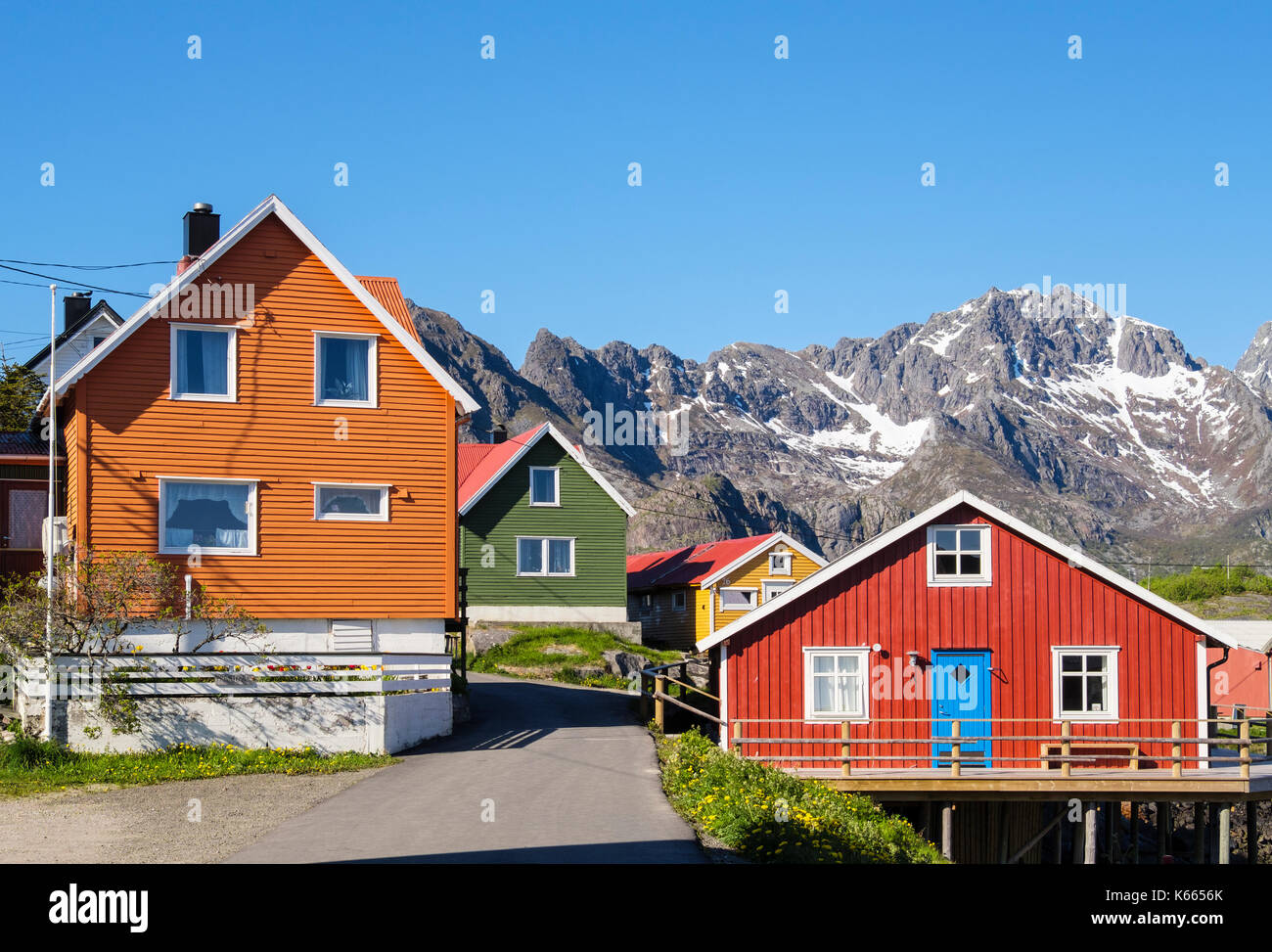 Typical colourful Norwegian architecture wooden houses in Henningsvaer, Austvågøya Island, Lofoten Islands, Nordland, Norway, Scandinavia - Stock Image