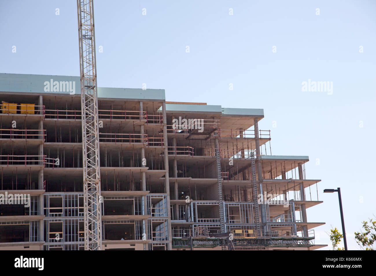 steel beams and concrete floors inside a multi-story building under construction - Stock Image