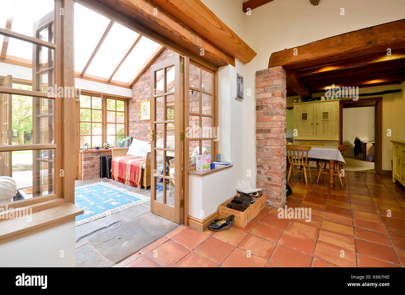 conservatory and kitchen in country cottage - Stock Image