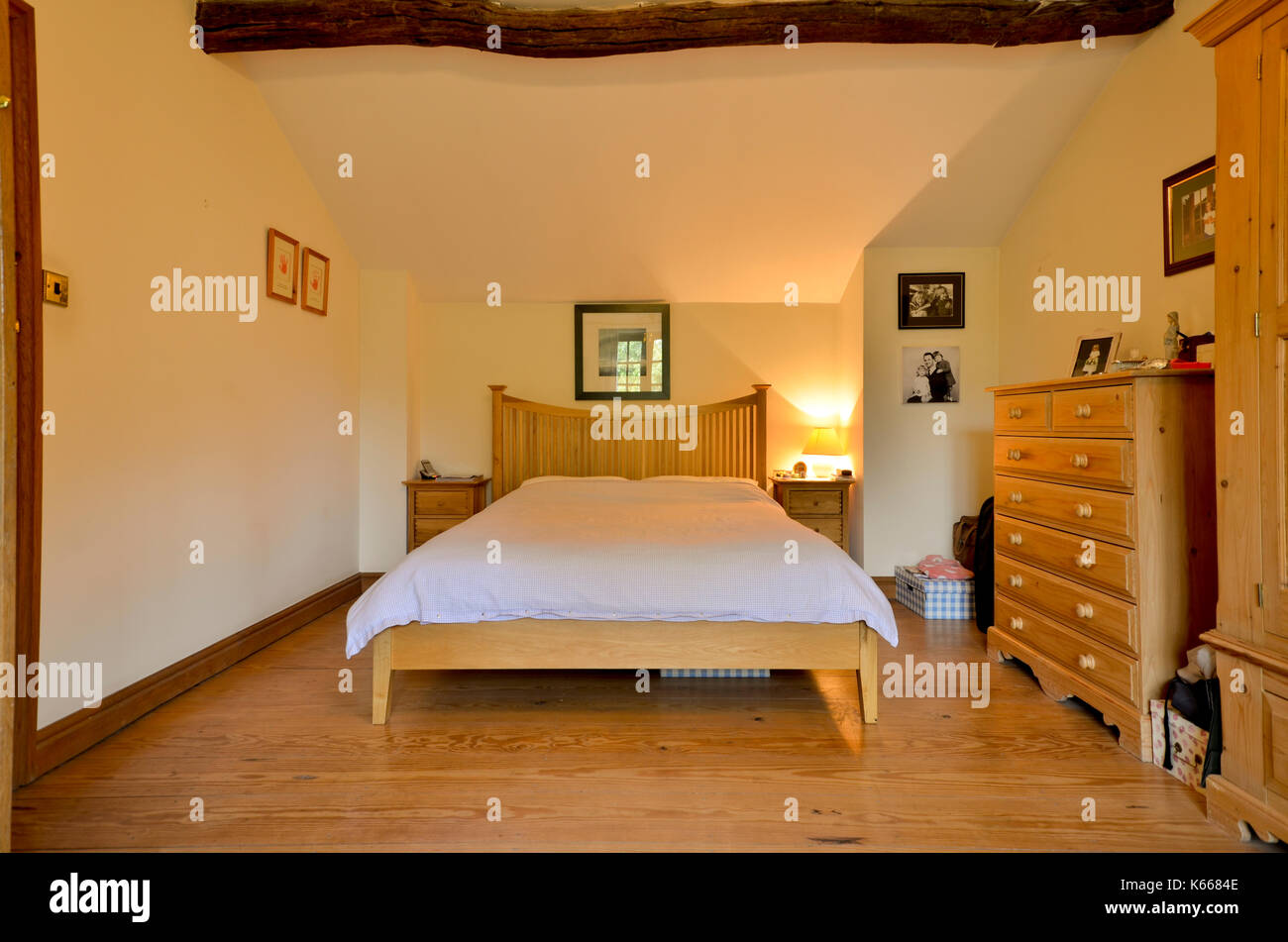 Guest bedroom in cottage with exposed beam Stock Photo