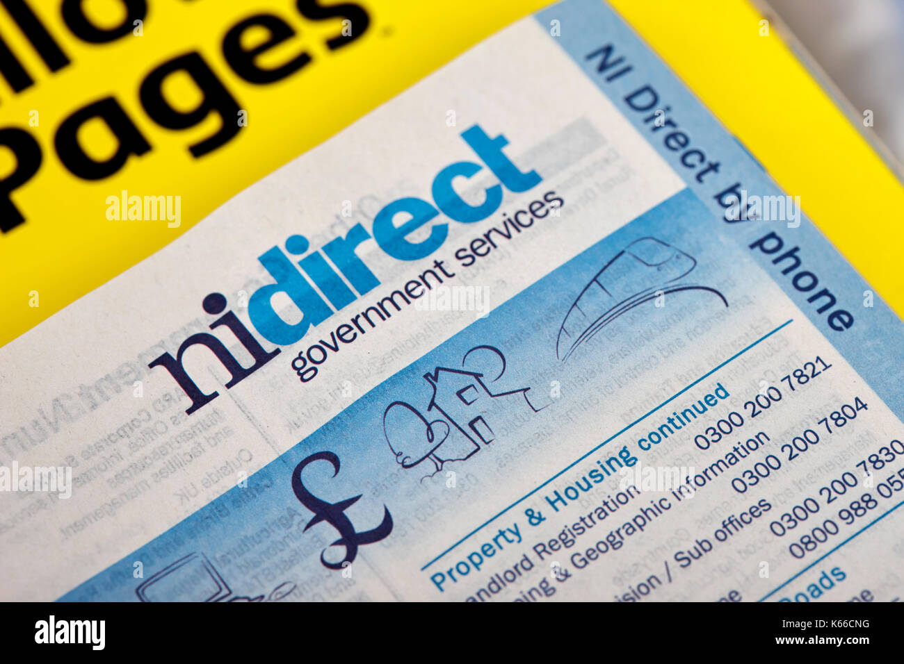 nidirect local government services numbers in yellow pages classified telephone directory paper edition uk - Stock Image