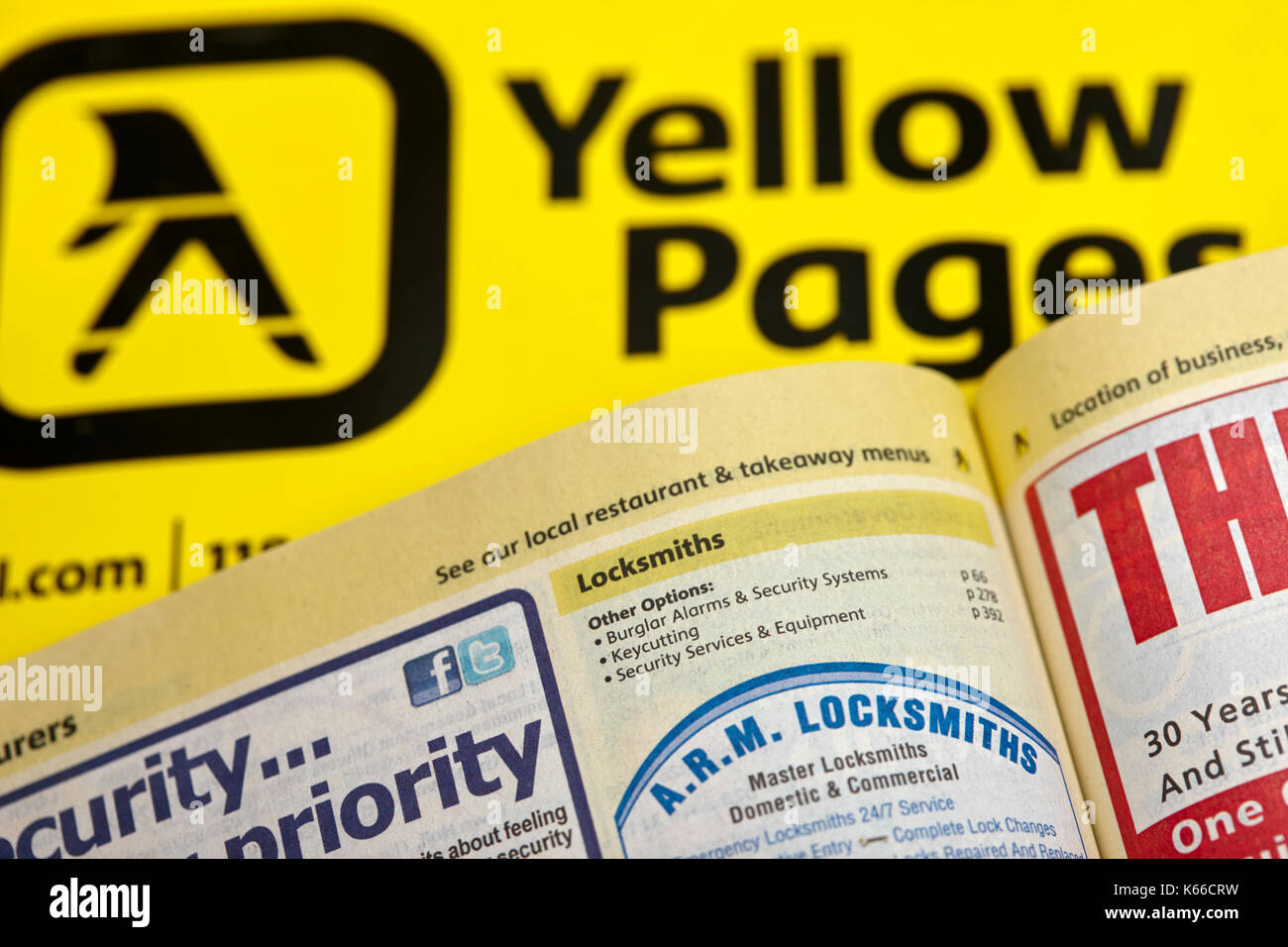 locksmith category in yellow pages classified telephone directory paper edition uk - Stock Image