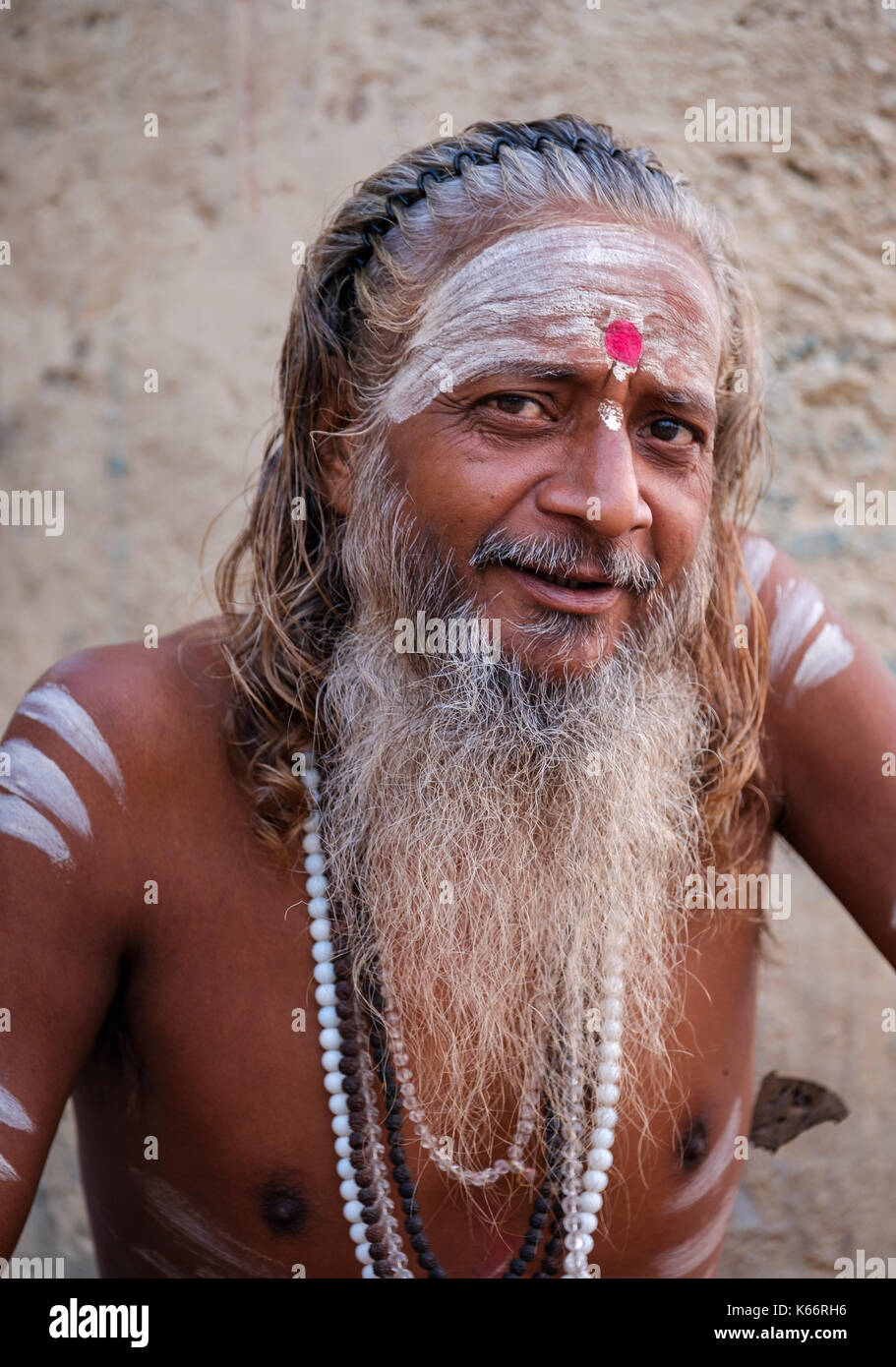 VARANASI, INDIA - CIRCA NOVEMBER 2016: Portrait of a Sadhu in Varanasi. The Sadhus or Holy Man are widely respected in India. Varanasi is the spiritua - Stock Image