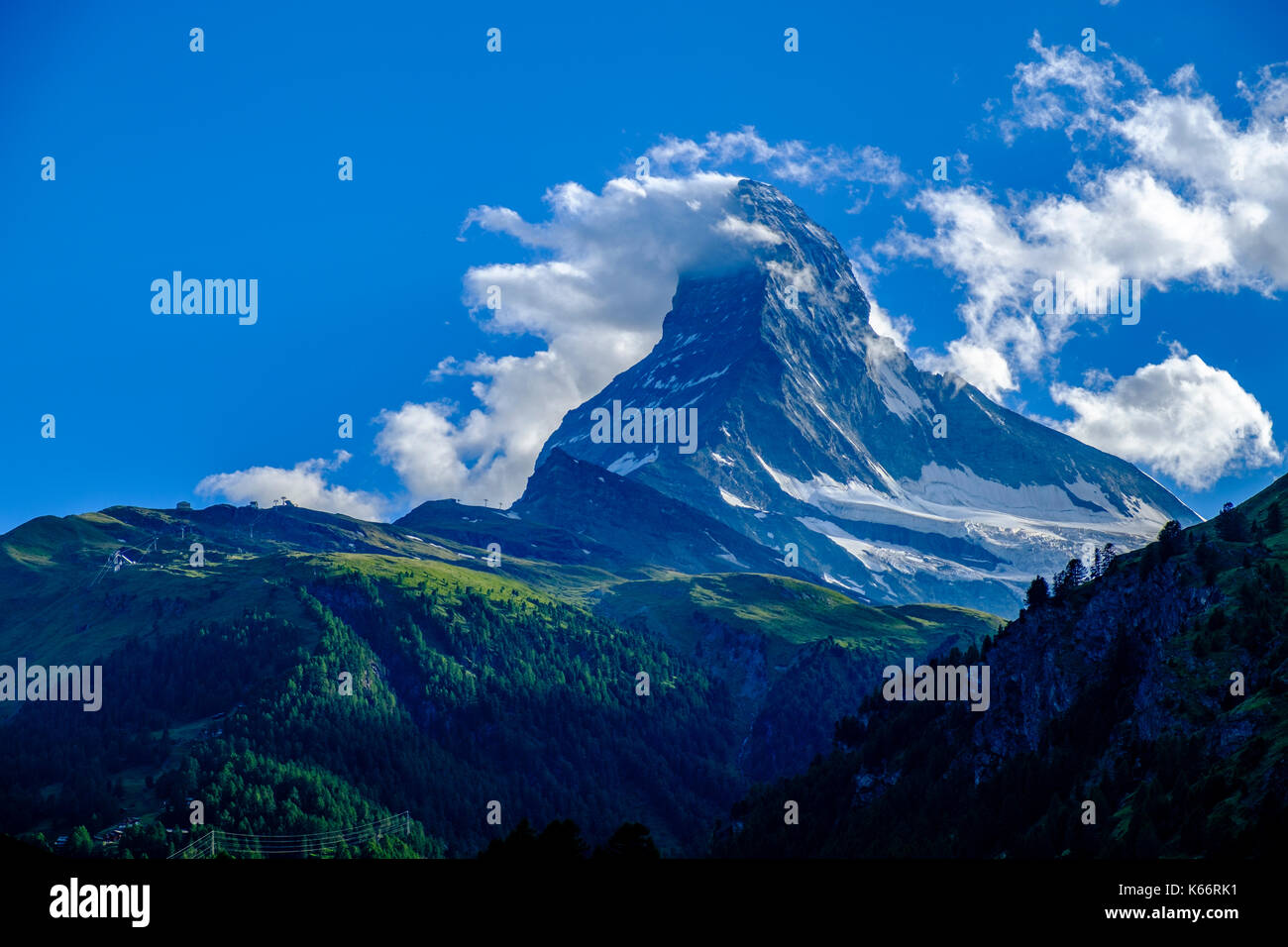 The East and North Face of the Matterhorn, Monte Cervino, with Clouds around the summit - Stock Image