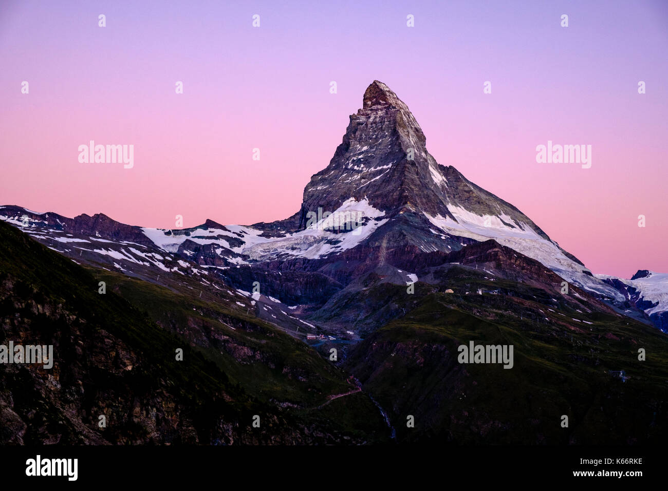 The East and North Face of the Matterhorn, Monte Cervino, with purple sky before sunrise - Stock Image