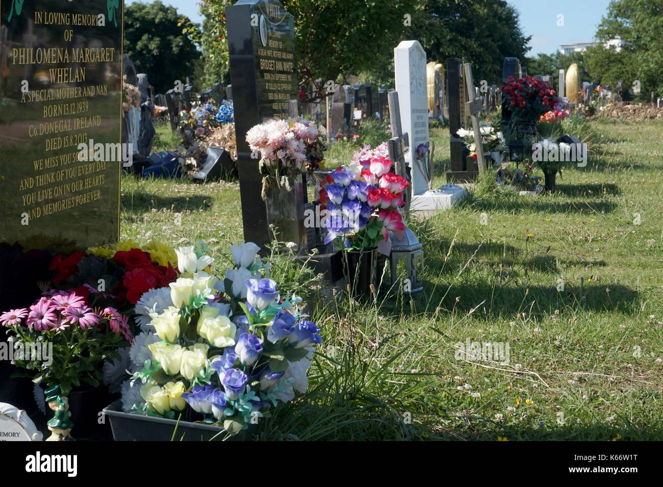 Fake Flowers On A Grave In Saint Marys Catholic Cemetery In Kensal