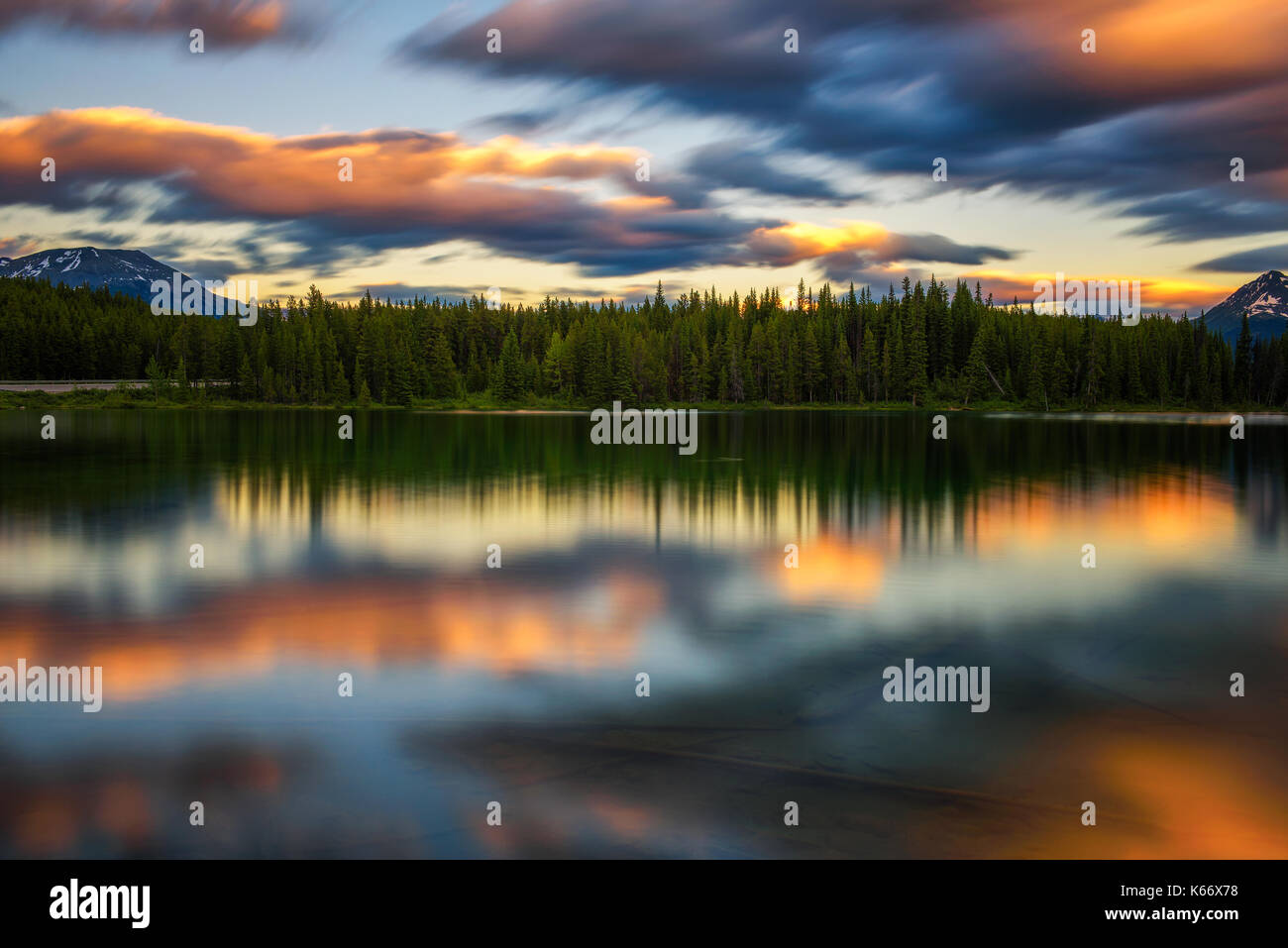Scenic sunset over Herbert Lake along the roadside of the Icefields Parkway in Banff National Park, Alberta, Canada. - Stock Image