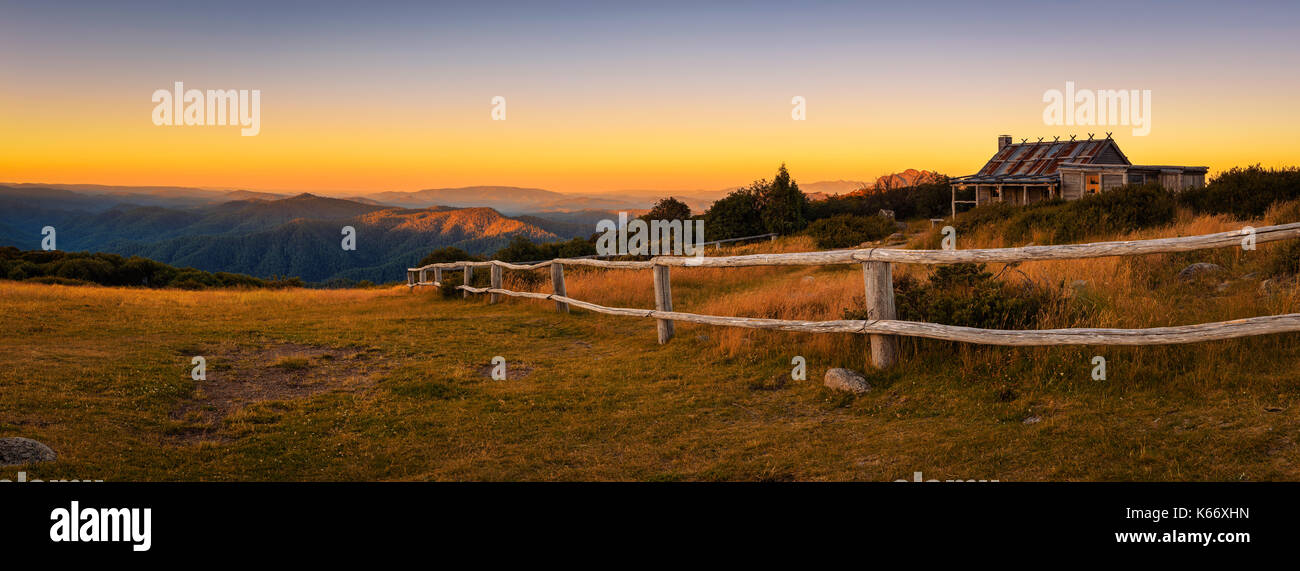 Sunset above Craigs Hut, built as the the set for Man from Snowy River movie in the Victorian Alps, Australia - Stock Image