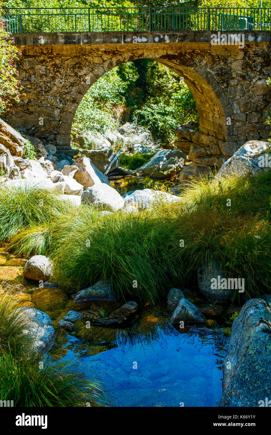Lapa dos Dinheiros nature landscape with a old stone bridge - Stock Image