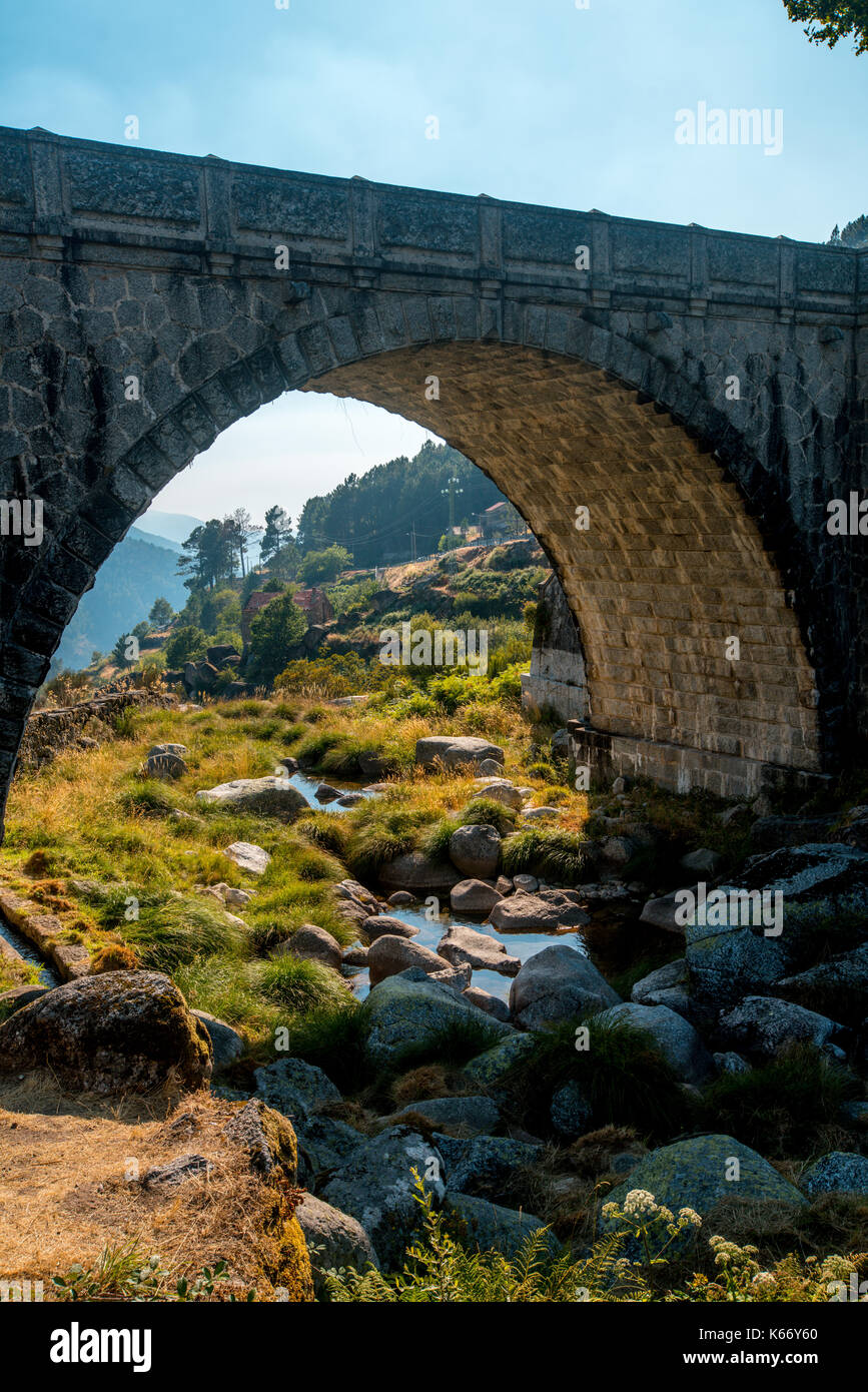 Old and beautiful stone bridge - Stock Image