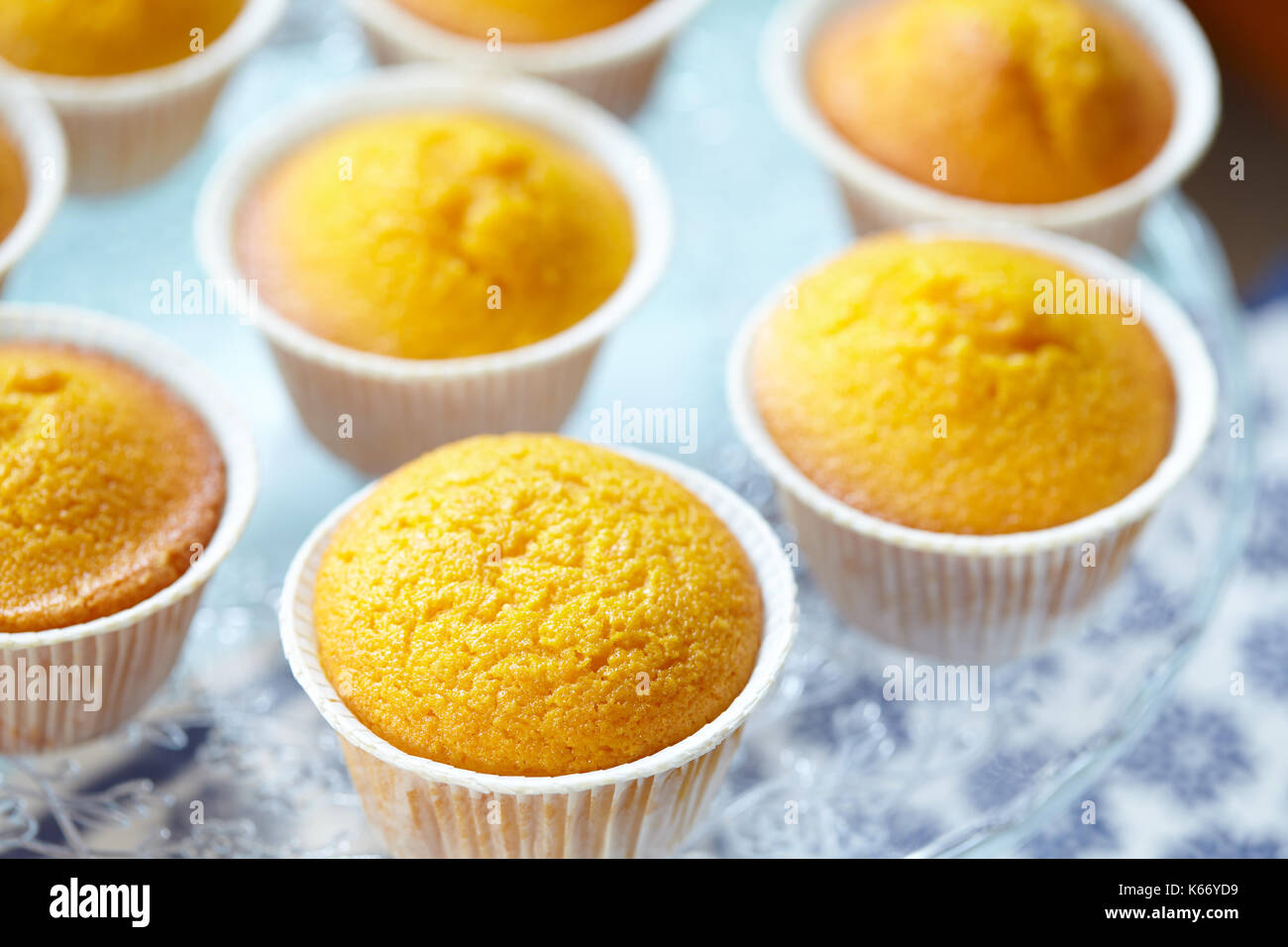 Closeup view of cake stand with Italian muffins called Camilla, nade with carrot and almonds, selective focus. - Stock Image