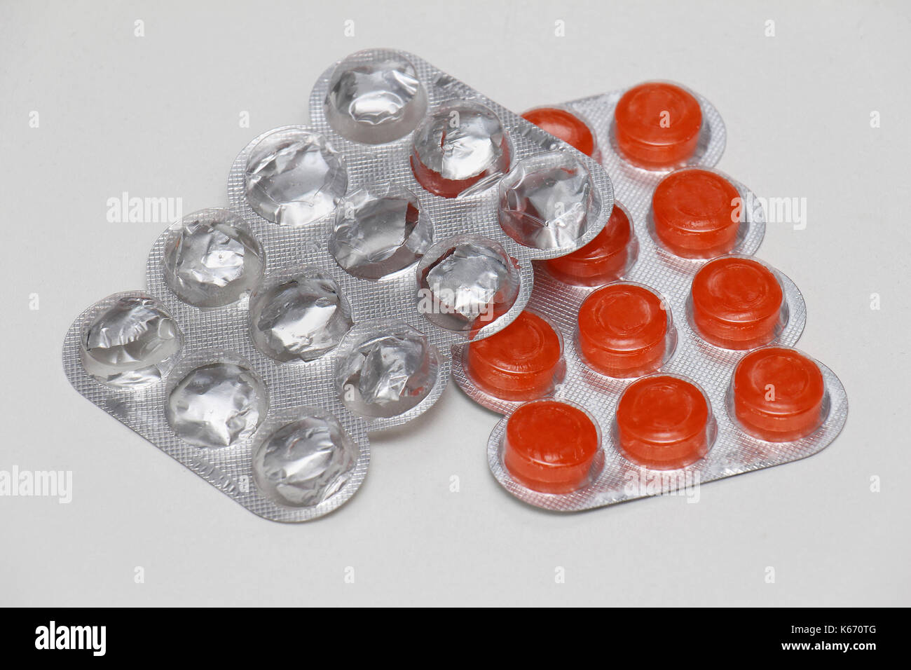 Medical lozenges healing sore throat in plastic blisters - Stock Image