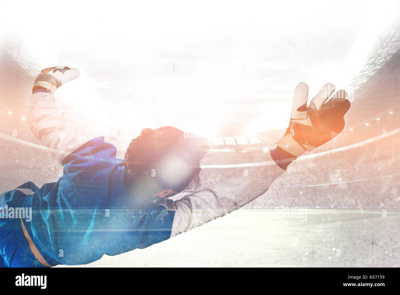 Diving goalkeeper n the stadium - Stock Image