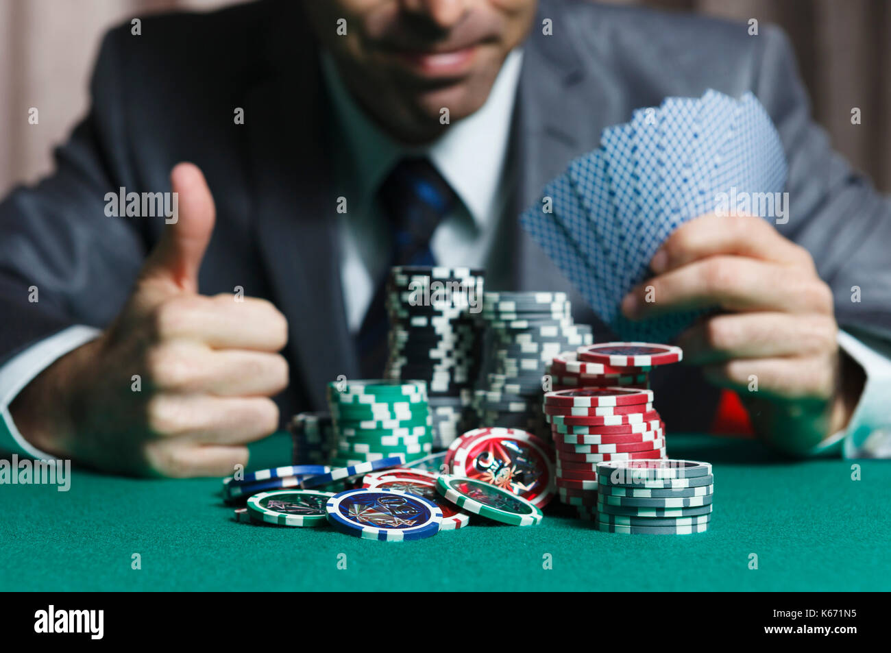 Blackjack In A Casino Man With Cards Wins Gets Rich, Shows A Big Like - Stock Image
