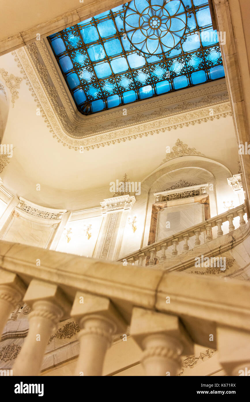 Looking one of the staircases inside Bucharest's Palace of the Parliament at an ornate skylight. - Stock Image