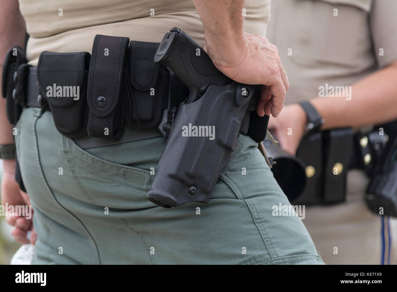 big sale 2076f 7f3cf Police officer's duty belt with weapon, ammo pouches, and handcuff ...