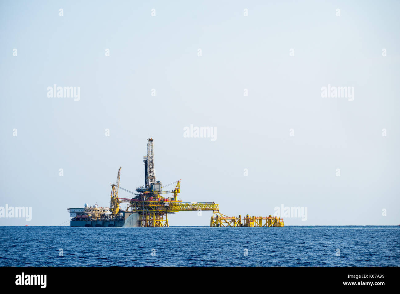 Offshore oil rig and tanker Stock Photo