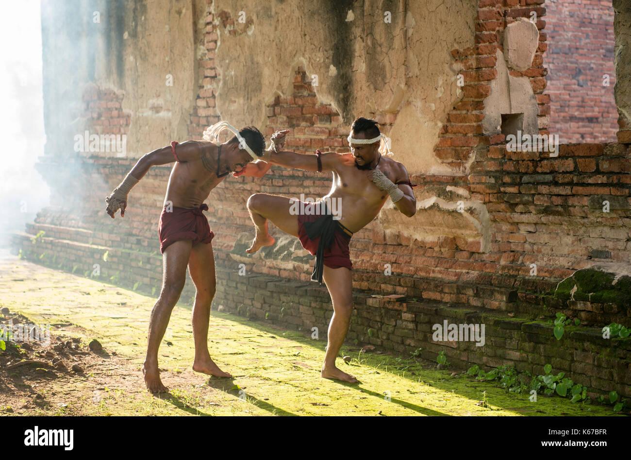 Two Thai boxers fighting, Thailand - Stock Image