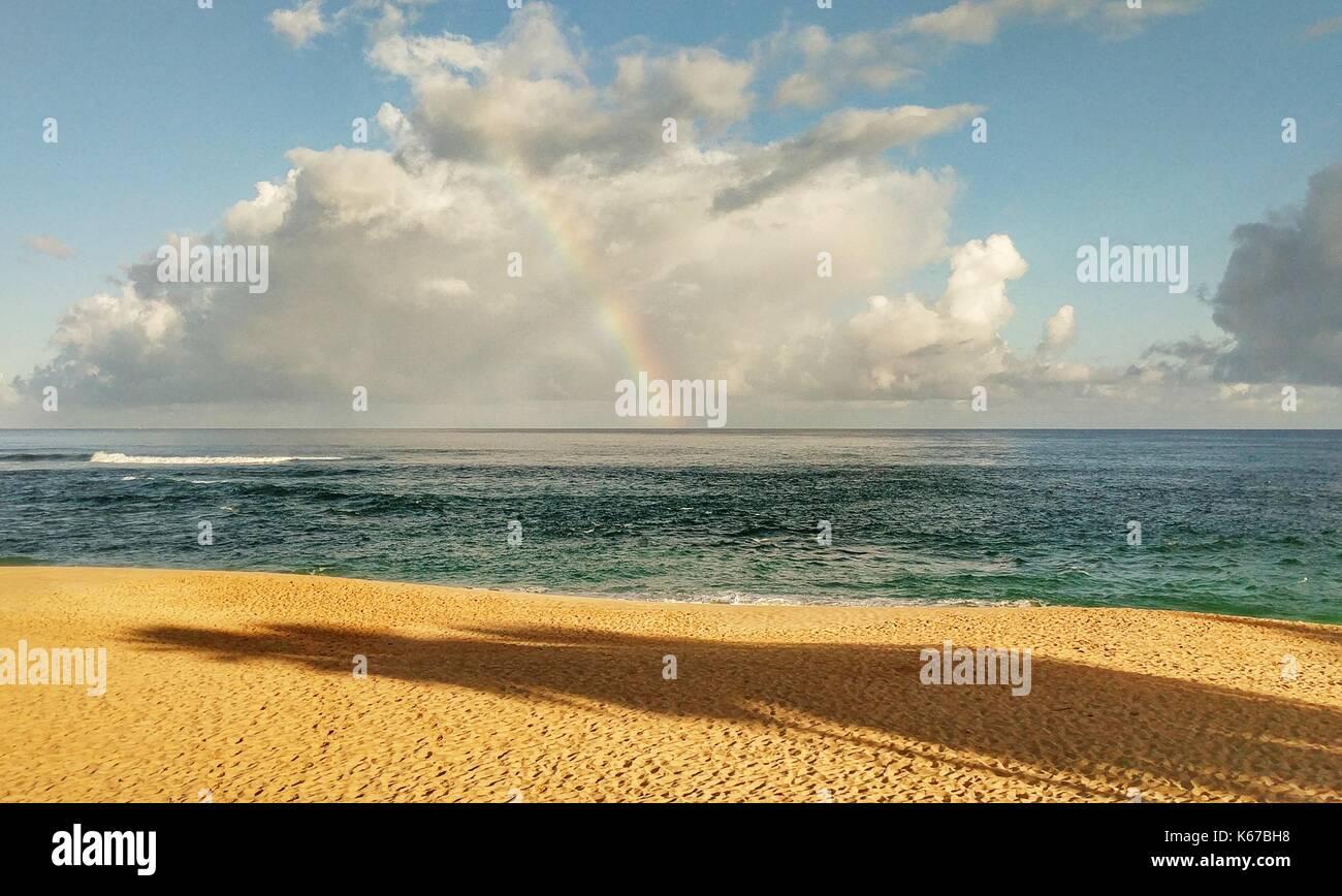 Rainbow over the horizon, North Shore, Oahu, Hawaii, America, USA - Stock Image