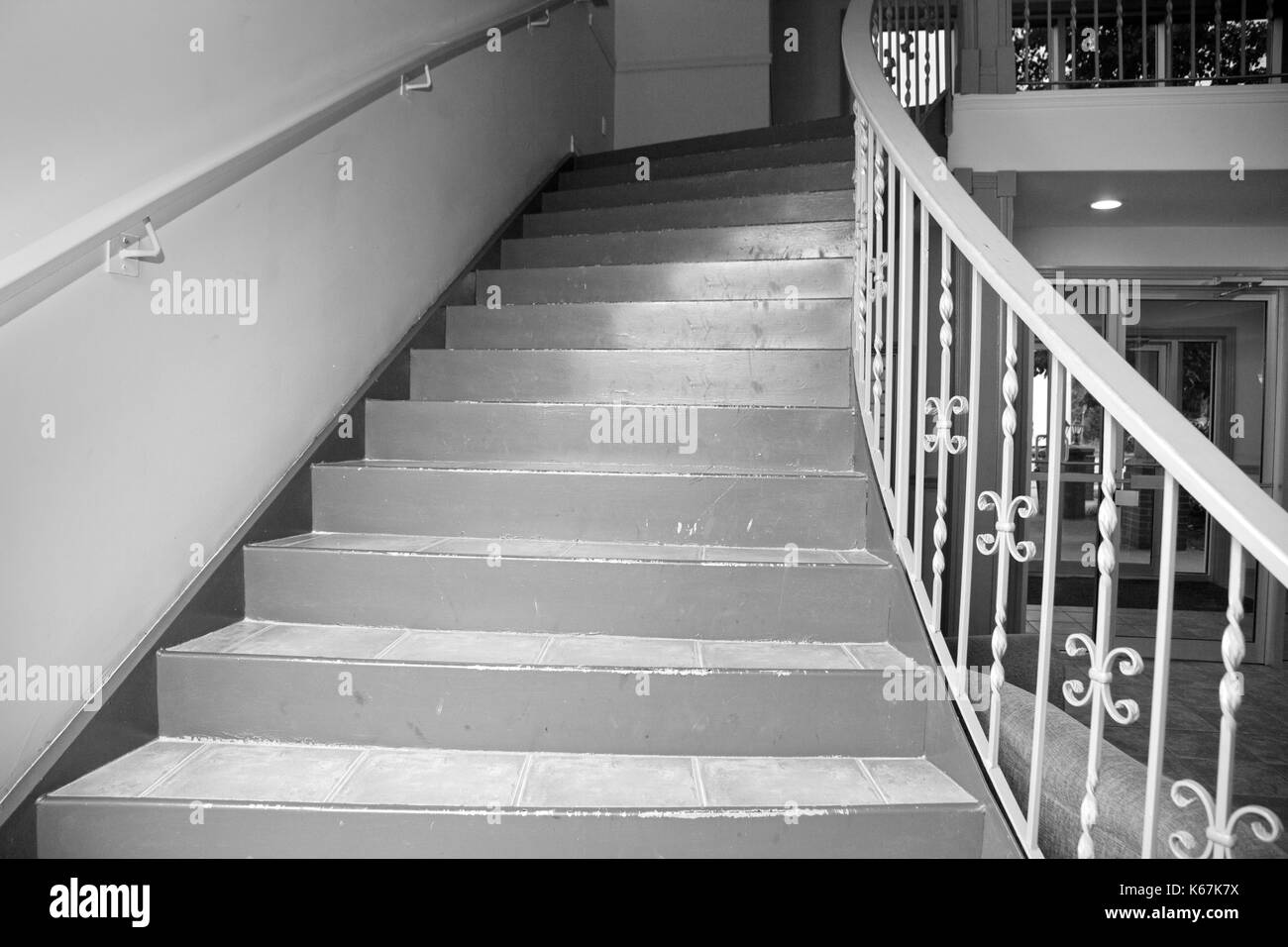 black and white view of old apartment building staircase - Stock Image