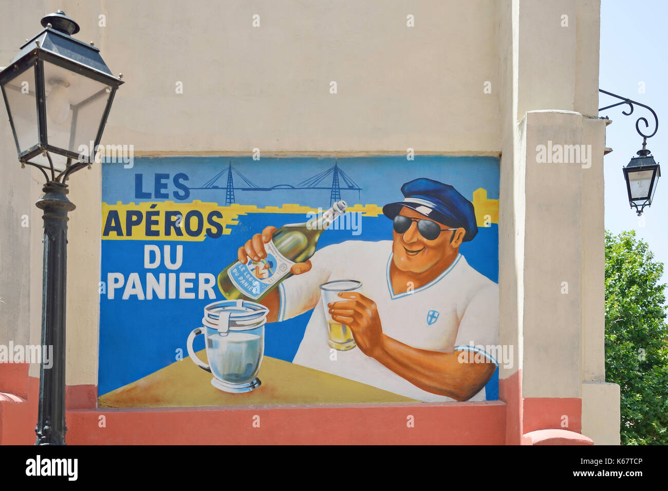 Painted advertisement on wall in Old Panier Quarter, Marseille, Bouches-du-Rhône, Provence-Alpes-Côte d'Azur, France - Stock Image