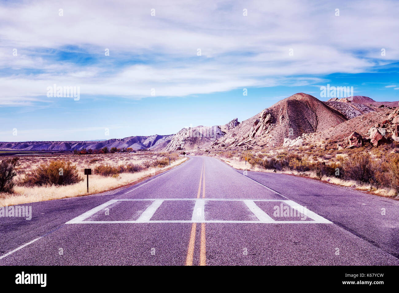 Vintage toned picture of a scenic deserted road, USA. - Stock Image