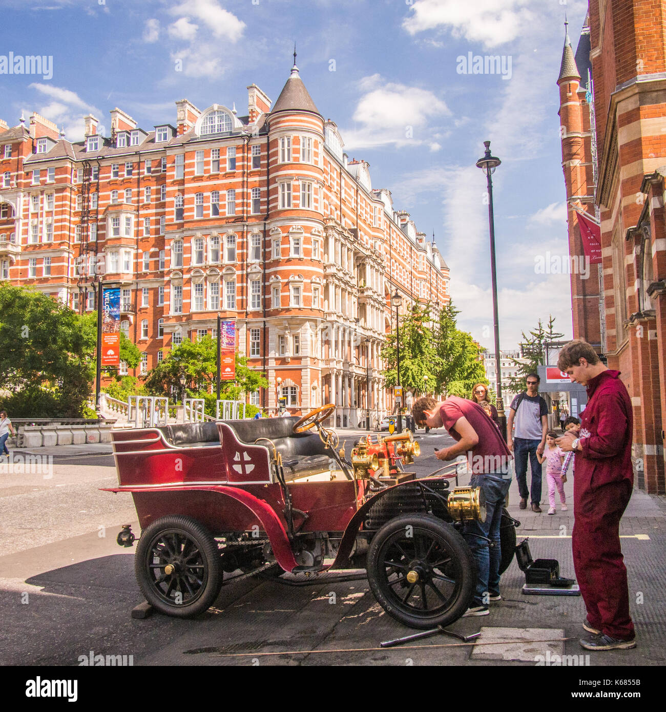 Mechanics working on a classic car in Kensington, London Stock Photo