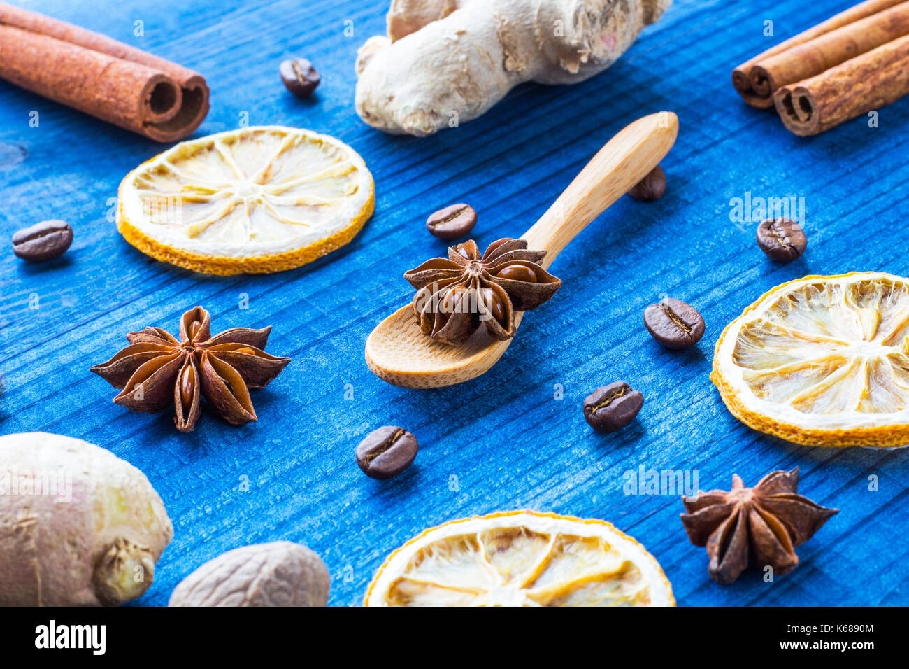 star anise on wooden spoon with spices - Stock Image