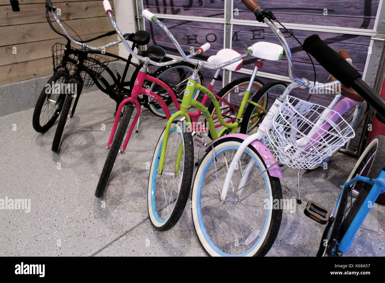 A row of bicycles parked in a garage. - Stock Image