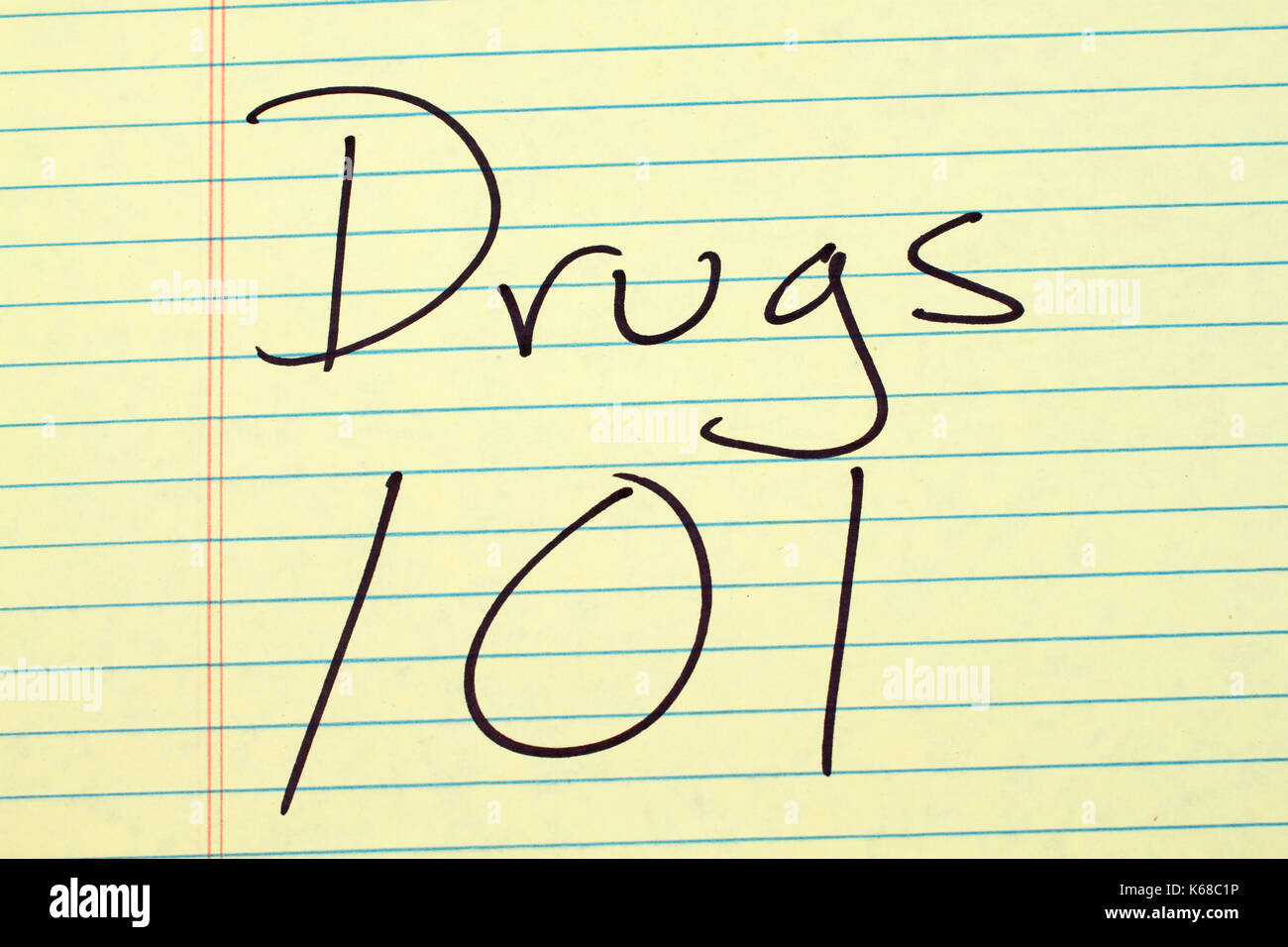 The words 'Drugs 101' on a yellow legal pad - Stock Image